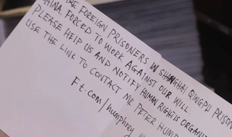The issue of forced labor came to light when a 6-year-old girl in south London found a card in her box already had a message written inside. (Image: YouTube/Screenshot)