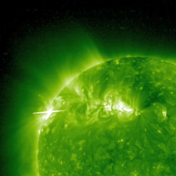 This ultraviolet image, captured by NASA's Solar Terrestrial Relations Observatory (STEREO) Ahead spacecraft on February 12, 2010, shows solar storms brewing in two active areas of the Sun. NASA image courtesy the STEREO science team. Caption by the STEREO science team and Holli Riebeek)