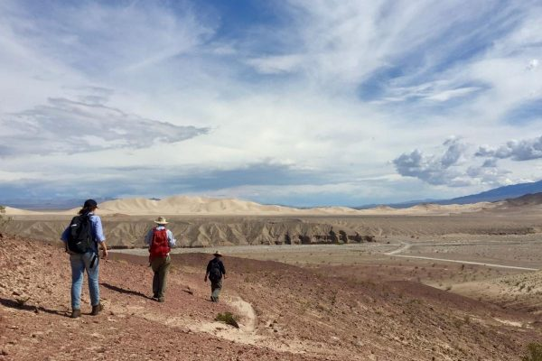 Researchers Ganqing Jiang, Malcolm Wallace and Alice Shuster head off into the desert in search of iron formations (Death Valley, California). (Image: Maxwell Lechte)