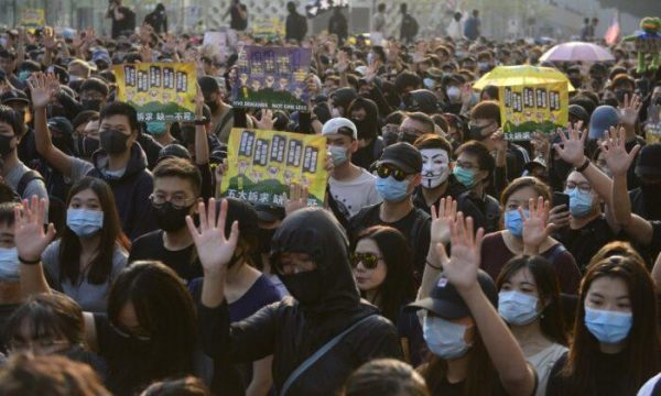Protesters raise their hands to signal their five demands in a march in Tsim Sha Tsui, Hong Kong. (Image: Gorden Yu/The Epoch Times)