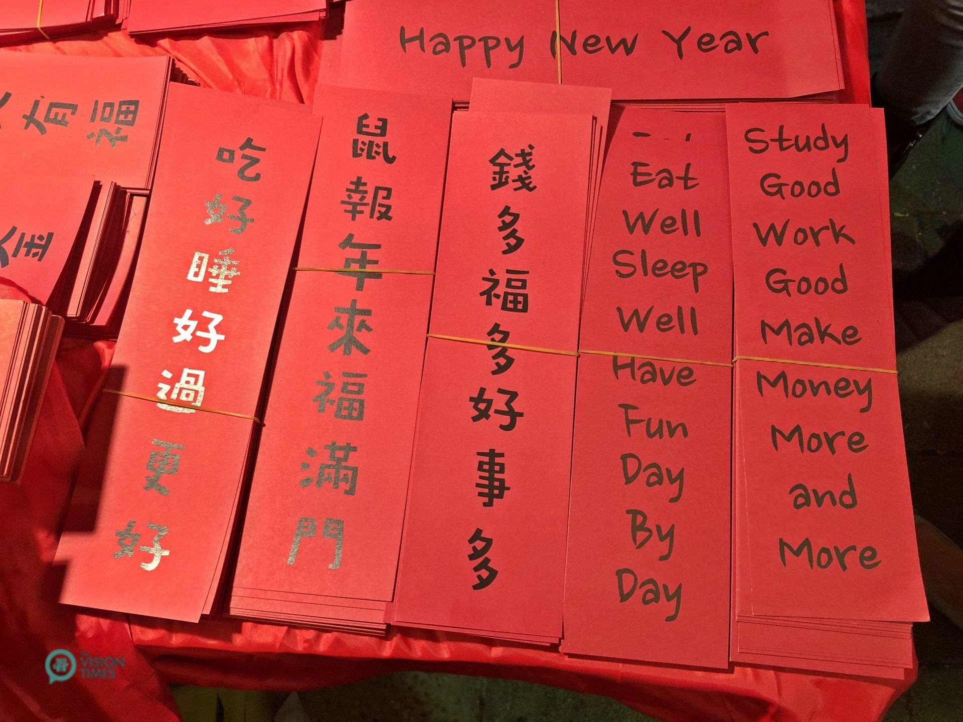There are a variety of red envelopes (紅包) and spring couplets (春聯) with innovative designs sold at the Lunar New Year Bazaar. (Image: Billy Shyu / Vision Times)