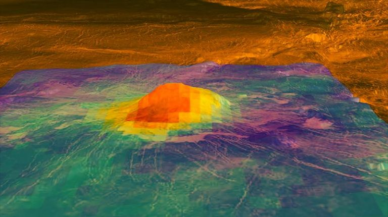 This figure shows the volcanic peak Idunn Mons (at 46 degrees south latitude, 214.5 degrees east longitude) in the Imdr Regio area of Venus. The colored overlay shows the heat patterns derived from surface brightness data collected by the Visible and Infrared Thermal Imaging Spectrometer (VIRTIS), aboard the European Space Agency's Venus Express spacecraft. (Image: NASA)