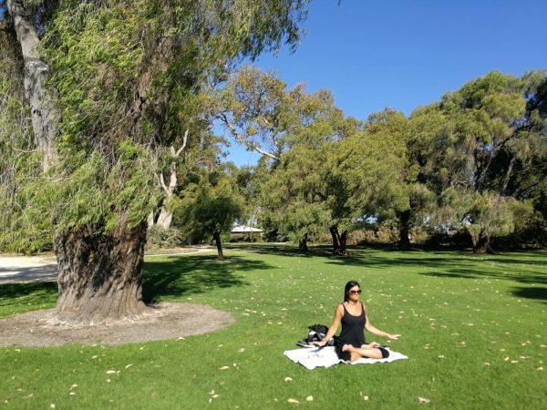 lady meditating under a tree