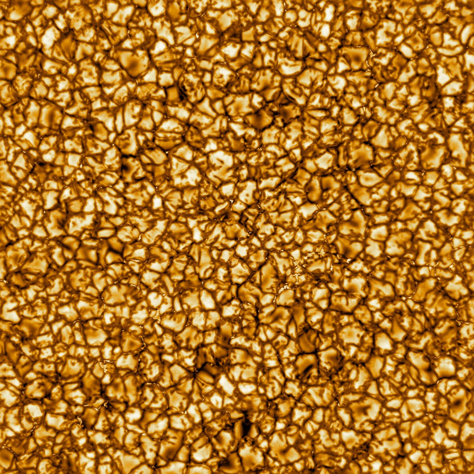 """The Daniel K. Inouye Solar Telescope has produced the highest resolution image of the sun's surface ever taken. In this picture, taken at 789 nanometers (nm), we can see features as small as 30km (18 miles) in size for the first time ever. The image shows a pattern of turbulent, """"boiling"""" gas that covers the entire sun. The cell-like structures -- each about the size of Texas -- are the signature of violent motions that transport heat from the inside of the sun to its surface. Hot solar material (plasma) rises in the bright centers of """"cells,"""" cools off and then sinks below the surface in dark lanes in a process known as convection. In these dark lanes we can also see the tiny, bright markers of magnetic fields. Never before seen to this clarity, these bright specks are thought to channel energy up into the outer layers of the solar atmosphere called the corona. These bright spots may be at the core of why the solar corona is more than a million degrees. (Image: NSO/AURA/NSF)"""