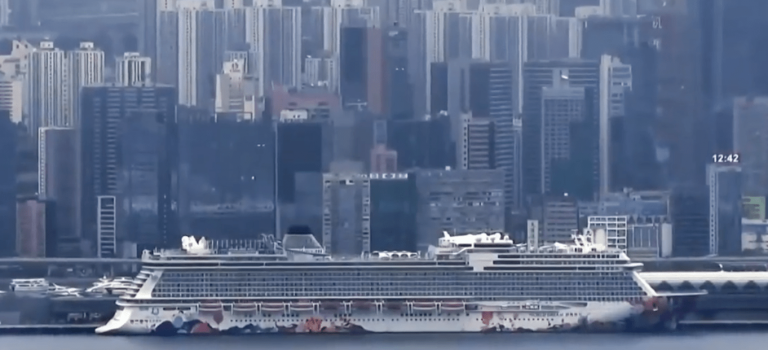In Hong Kong, 3,600 people remain quarantined on a cruise ship as officials conduct health checks, after eight former passengers tested positive for the novel coronavirus. (Image: YouTube/Screenshot)
