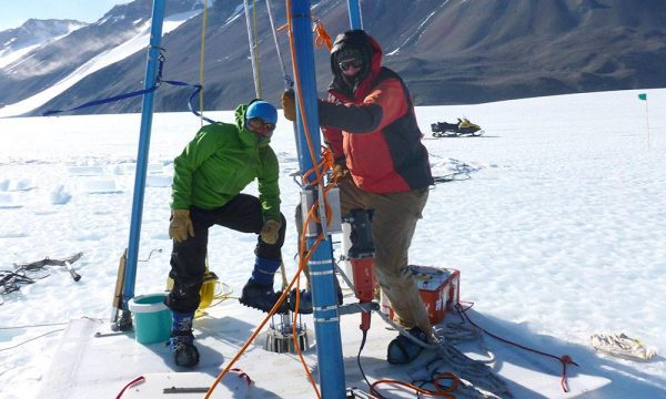 Researchers including Michael Dyonisius, left, drill ice cores in Antarctica. The researchers used the ice cores to determine how much of the potent greenhouse gas methane from ancient carbon deposits might be released to the atmosphere in warming conditions. (University of Rochester image / Vasilii Petrenko)