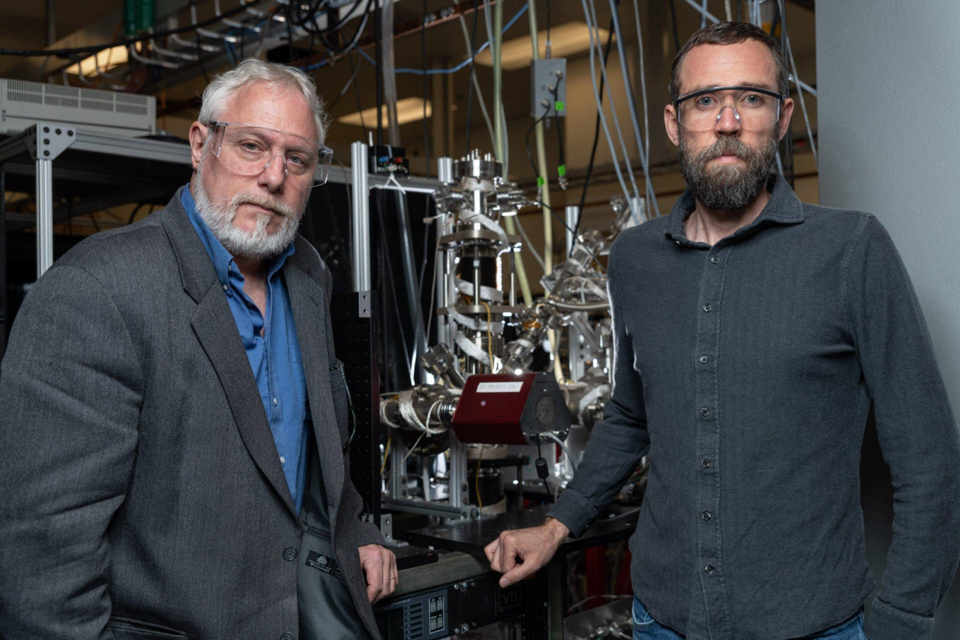 Scientists model a feasible chemical reaction, in which the Vulcan heat on Mercury could help it make ice at its poles: Georgia Tech's Thom Orlando (left) is the new Mercury study's principal investigator. Brant Jones (right) is first author. The two are also engineering the same chemistry in the lab to propose it as a method of making water for missions to the moon and to Mars. Orlando co-founded the Georgia Tech Center for Space Technology and Research. (Image Georgia Tech / Rob Felt)