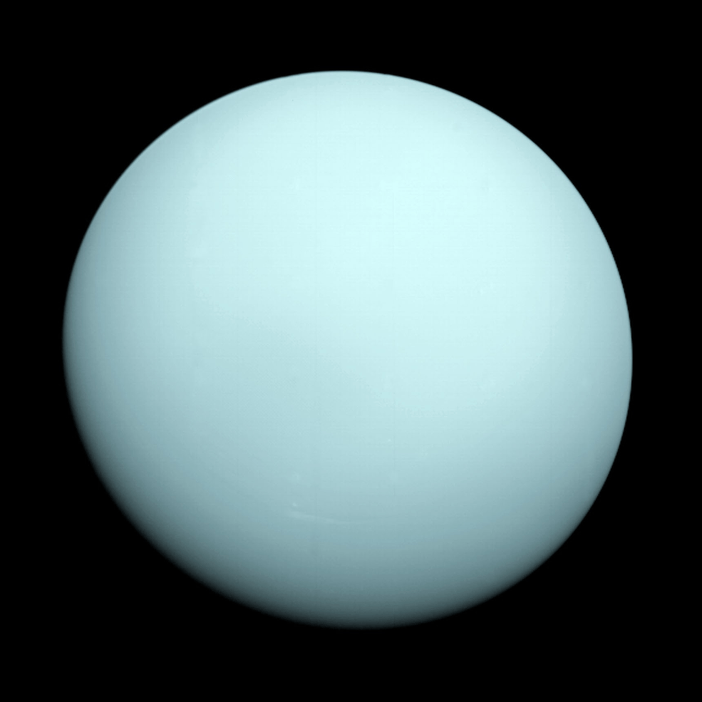 Voyager 2 took this image as it approached the planet Uranus on Jan. 14, 1986. The planet's hazy bluish color is due to the methane in its atmosphere, which absorbs red wavelengths of light. (Image: NASA/JPL-Caltech)