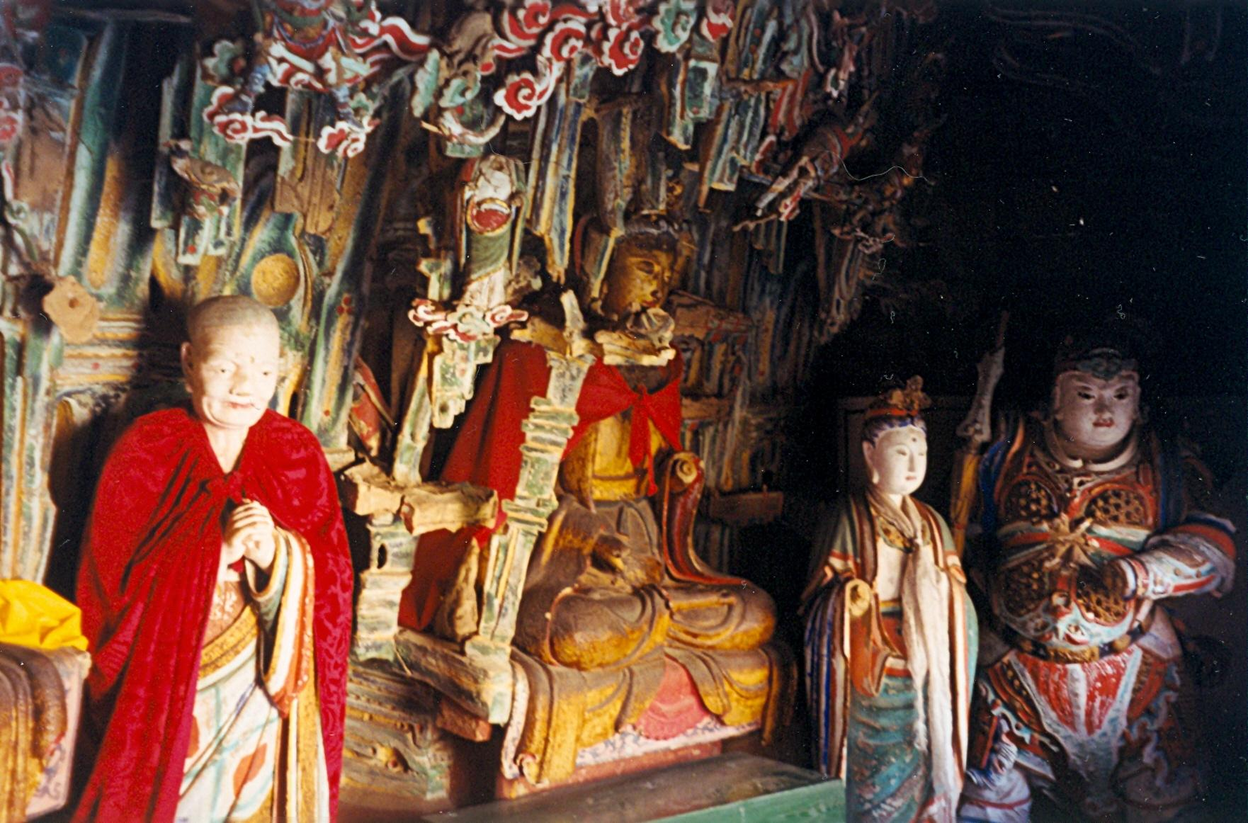 """At its highest peak is the main hall, the """"Sanjiao Temple"""", with a Sakyamuni Buddha sitting in the center, Confucius on the left, and a Taoist Sovereign on the right. (Image: Doron via wikimedia CC BY-SA 3.0)"""