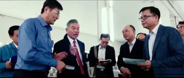 "Taiwan's 34 face mask manufacturing companies and machine tool companies teamed up to from the ""national face mask team."" (Image: YouTube film screenshot)"