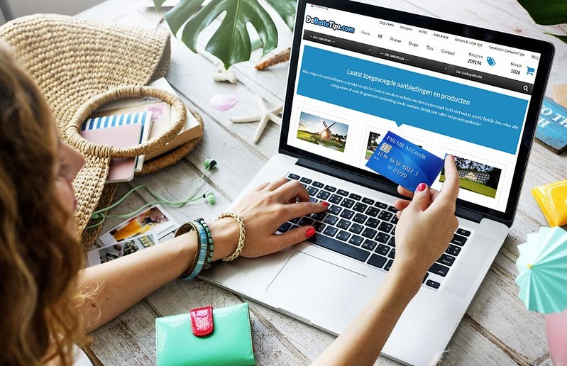 A female with credit card in hand, just about to finalize her online shopping purchase.