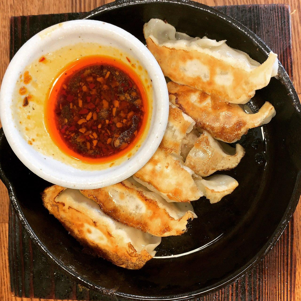 Potstickers with chili oil. (Image: Nakashi via Flickr CC BY-SA 2.0)