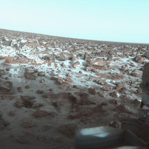 """NASA's Viking Lander landed at Utopia Planitia in 1979 and snapped this image of frost-covered soil and rocks. China's Tianwen lander will also land at Utopia Planitia. Image Credit: By """"Roel van der Hoorn (Van der Hoorn)"""" – Own work based on images in the NASA Viking image archiveSee accurate colors at: PIA00571: Ice on Mars Utopia Planitia Again, (Image: CCO1.0)"""