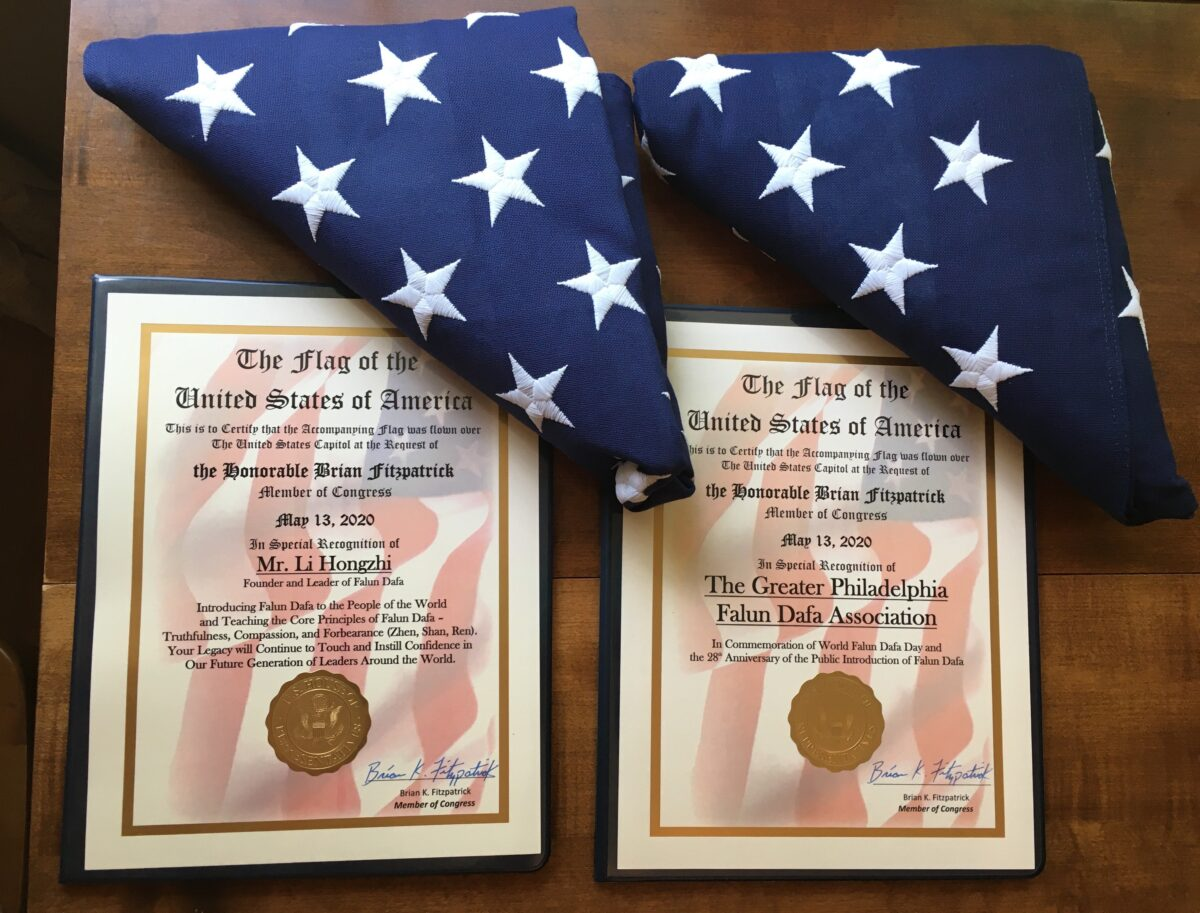 Certifications of the two American flags flown over the U.S. Capitol in honor of World Falun Dafa Day on May 13, 2020. (Image: Courtesy of Jennie Sheeks/via The Epoch Times)