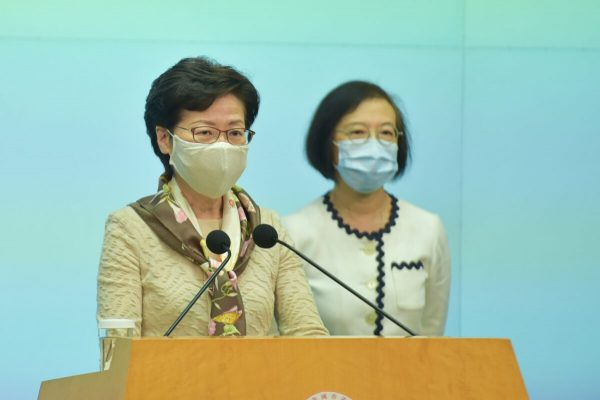 Hong Kong leader Carrie Lam (front) holds her weekly press conference in Hong Kong on June 2, 2020. (Bill Cox/The Epoch Times)