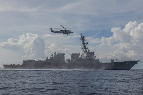 An MH-60R Seahawk helicopter assigned to the Warlords of Helicopter Maritime Strike Squadron returns to the Arleigh Burke-class guided-missile destroyer USS Mustin somewhere in the South China Sea. (Image: U.S. Navy photo by Mass Communication Specialist 3rd Class David Flewellyn)