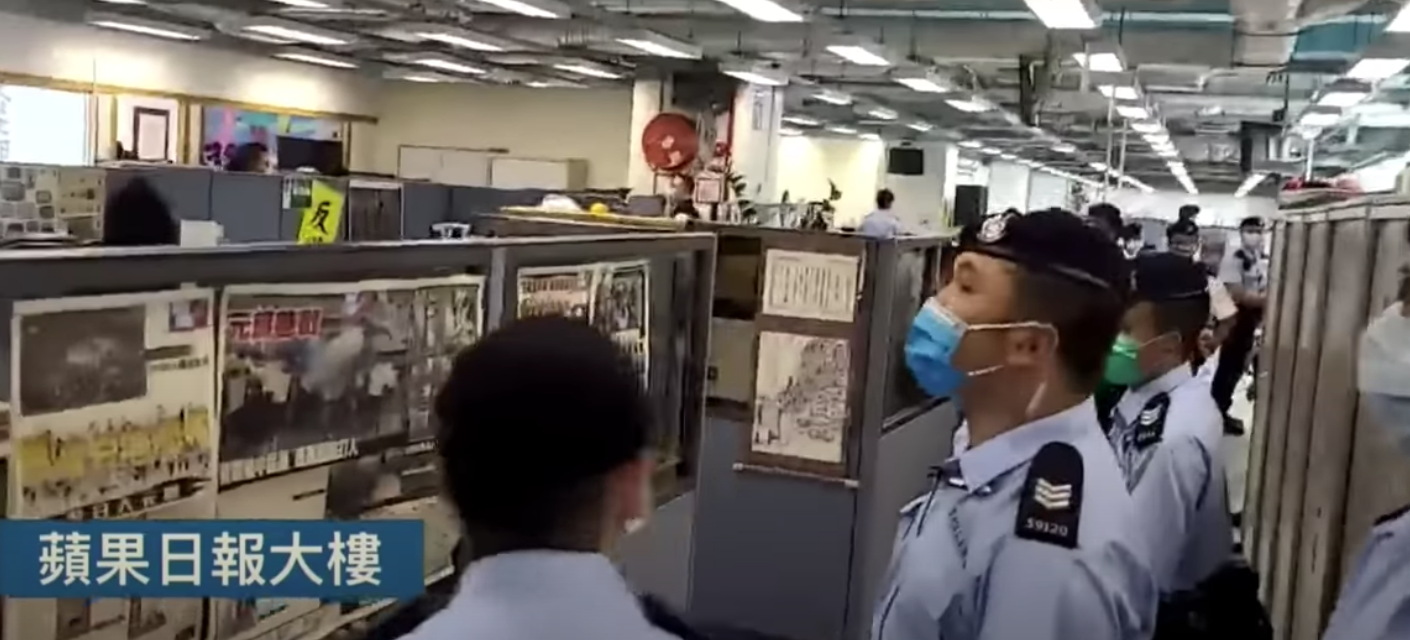 The newsroom of Apple Daily was also raided where six were arrested. (Image: YouTube/Screenshot)
