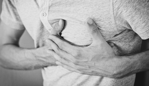 A person holding chest in pain.