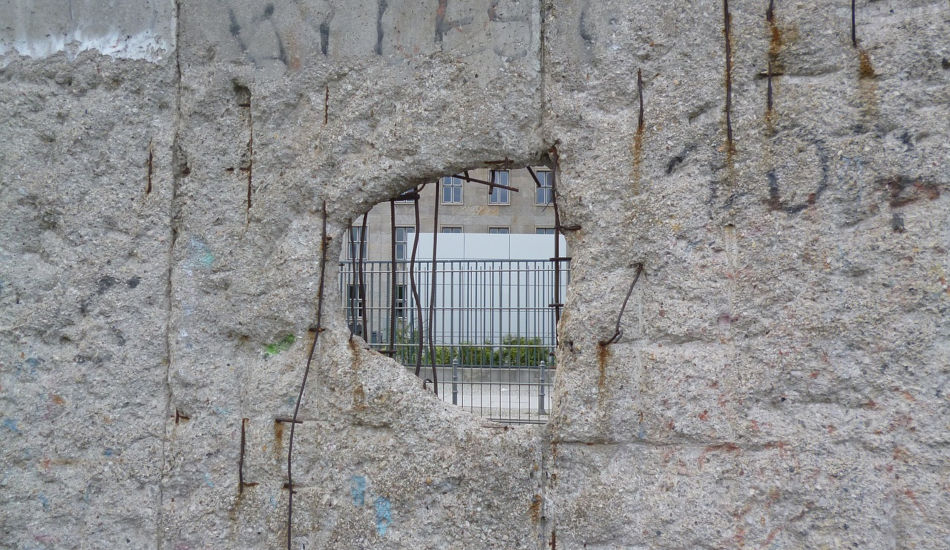 View through a hole in a concrete wall.