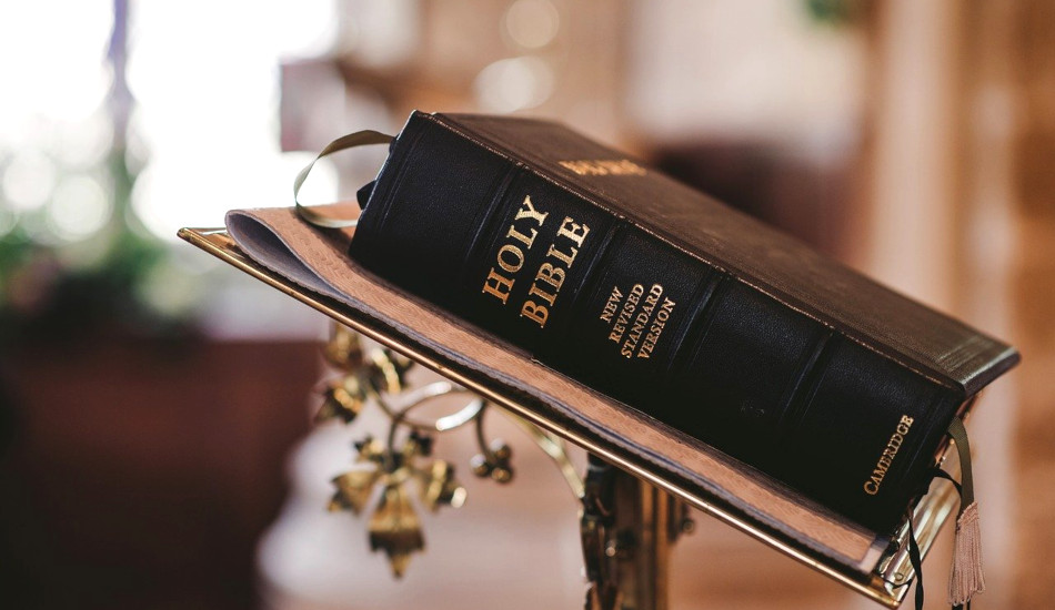 A bible sitting on a lectern.