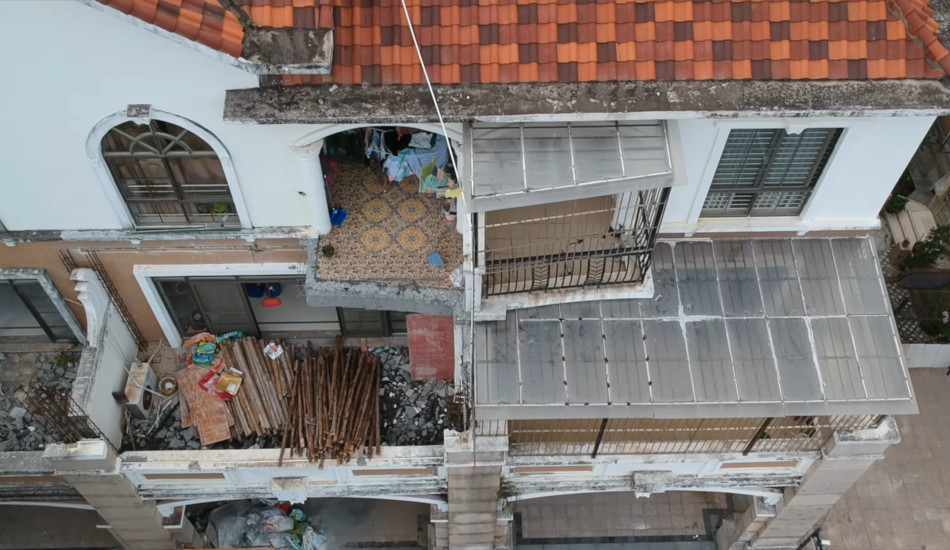 A 3-year-old building in China with walls, balconies, and part of the roof that have fallen off.