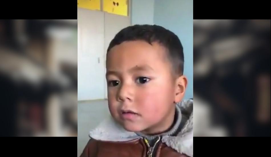 Abdurahman Tohti's son as seen in the propaganda video.