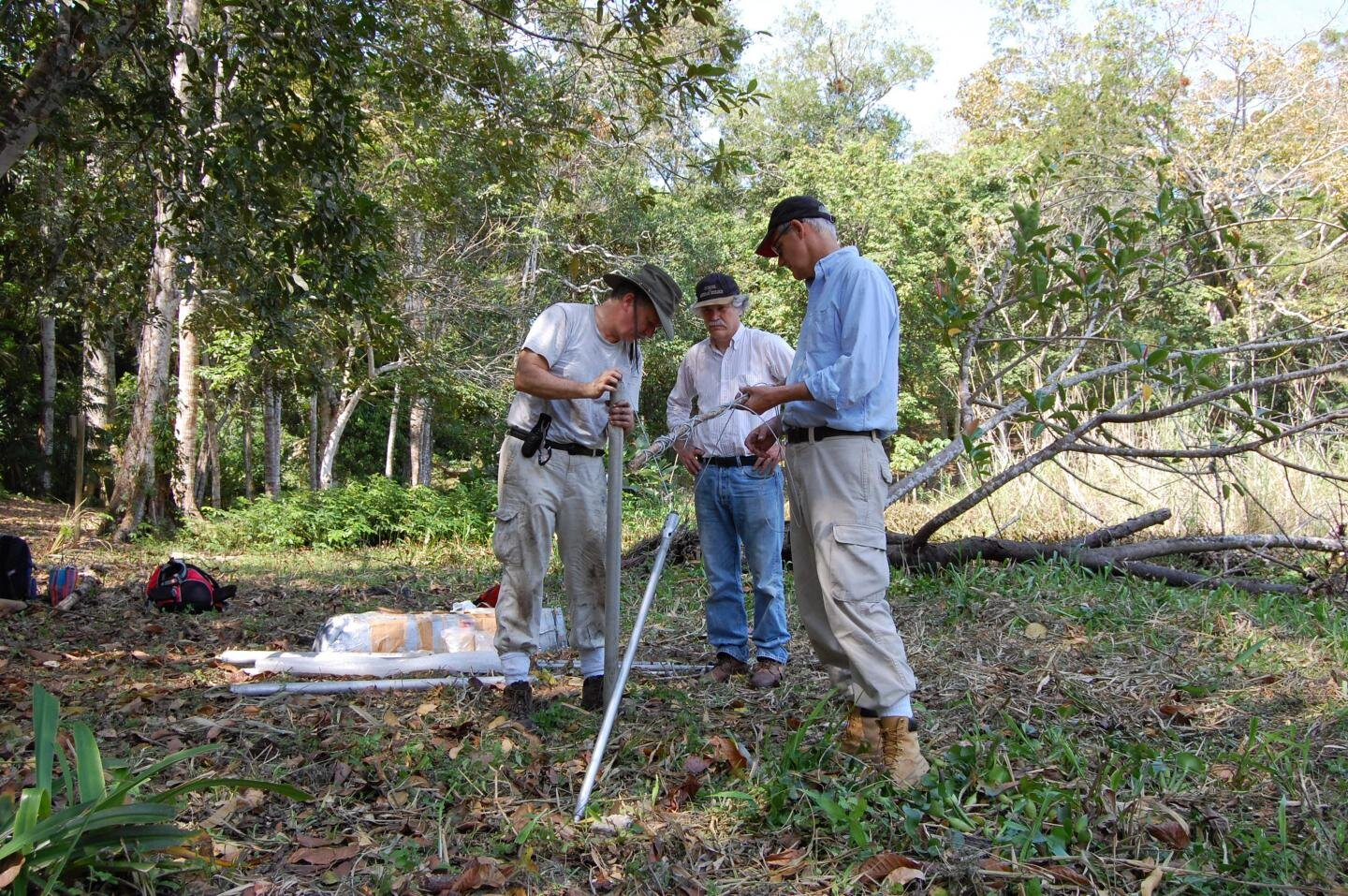 UC researchers Nicholas Dunning, left, Vernon Scarborough and David Lentz set up equipment to take sediment samples during their field research at Tikal. Credit: Liwy Grazioso Sierra