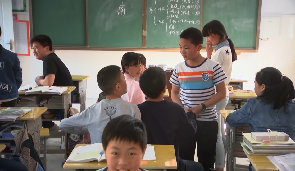 Chinese children playing in the classroom before school.