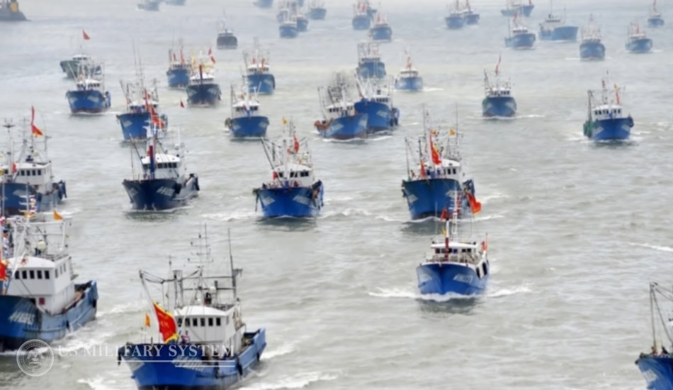 Dozens of Chinese trawlers out at sea.