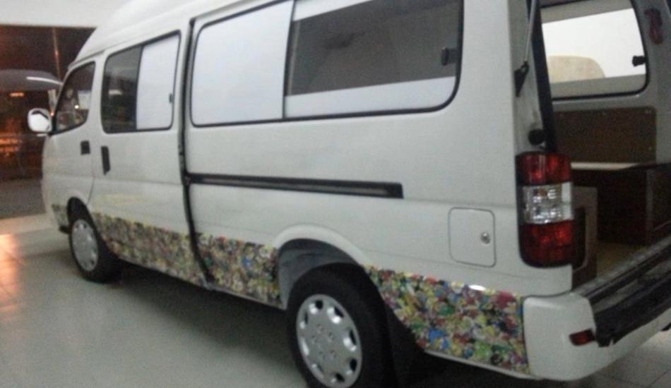 A Chinese Jinbei minibus.