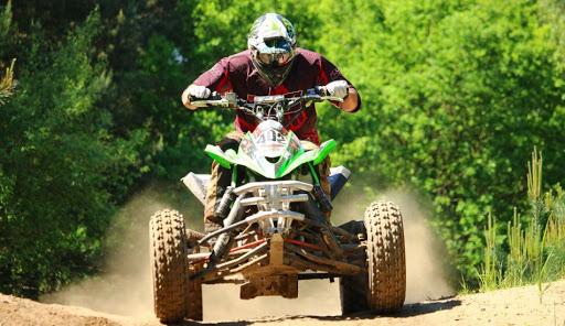 A person riding an ATV.