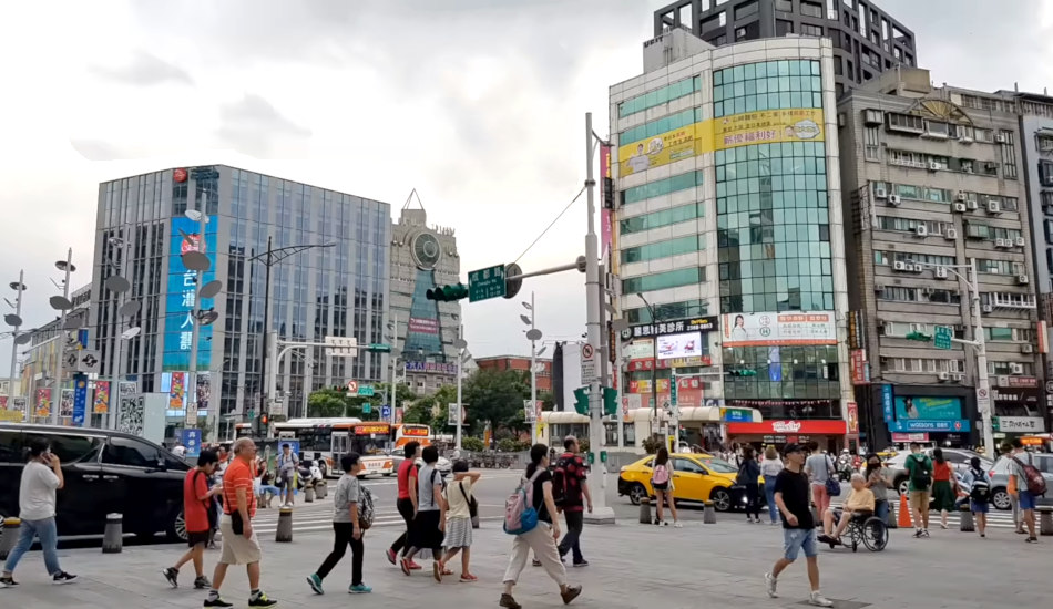 People cross the street in the Ximendig shopping district, the Times Square of Taiwan.