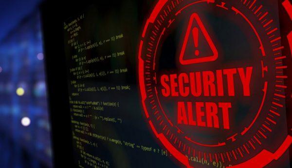 A computer screen displays a security alert.