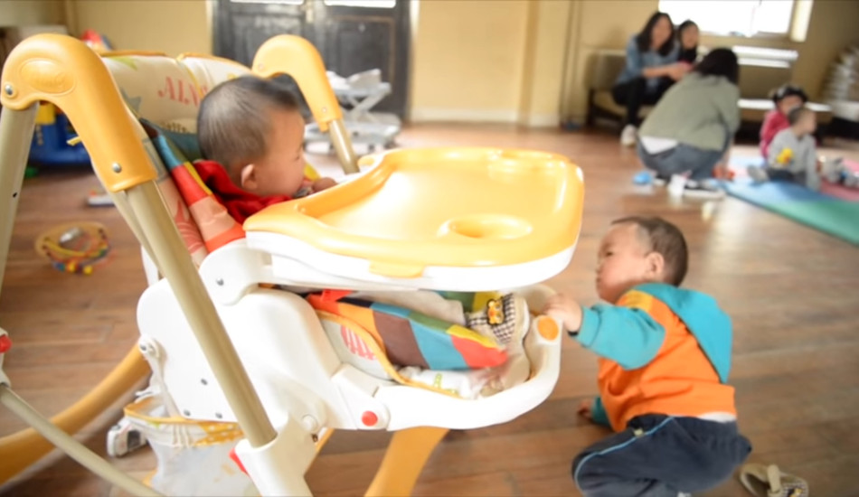 Two babies playing together at Shepherd's Field Children Village.