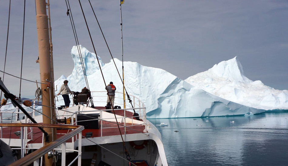 A team of U.S. navy scientists aboard a ship studying glacial ice melt.