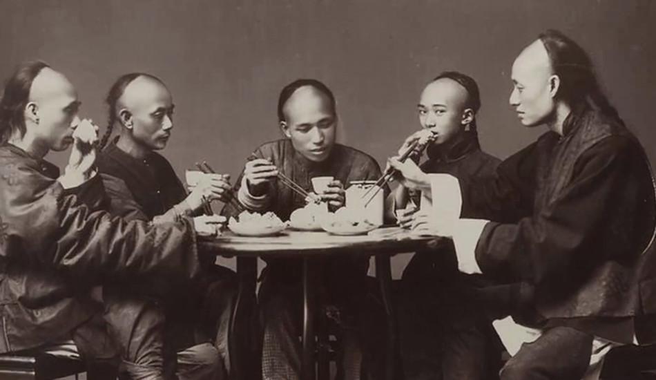 Five Manchu men share a meal.