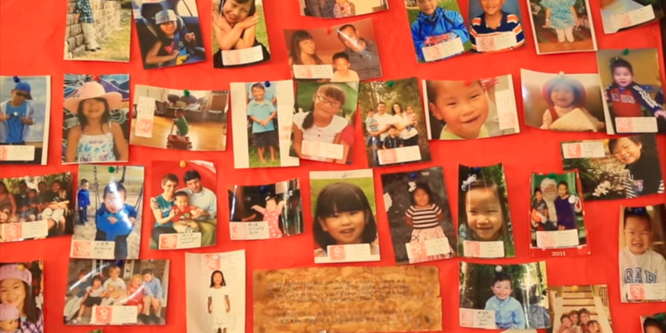 A wall full of photos of the Chinese children Baker rescued.
