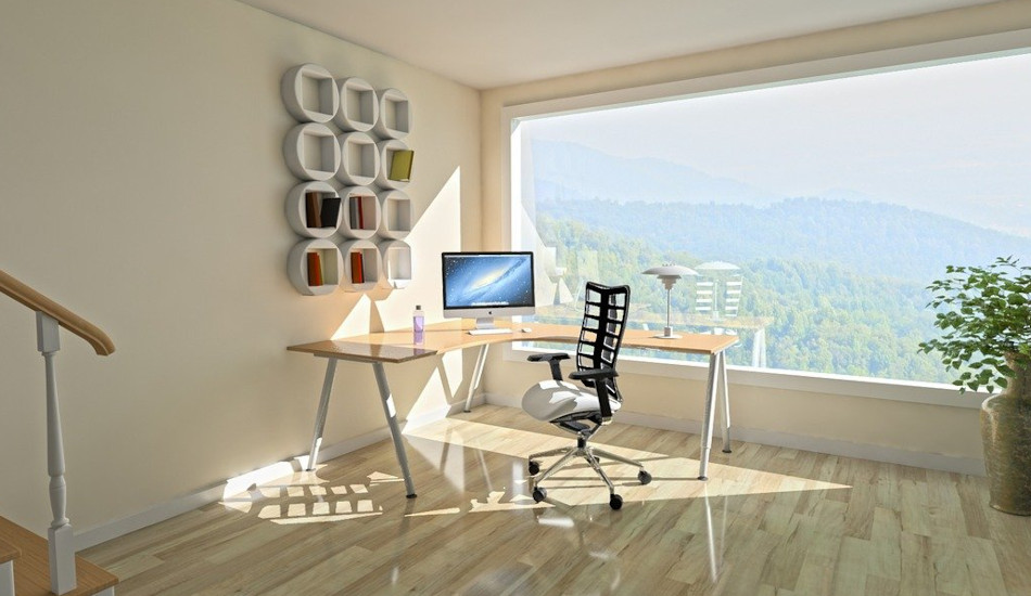 Home office area with desk near a picture window.