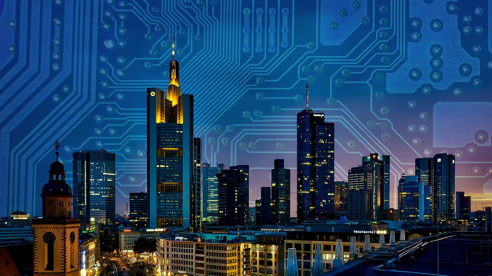 City displayed over a circuitboard.