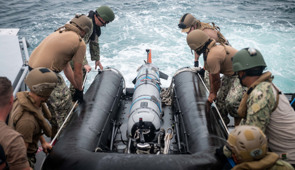 Sailors retrieve an unmanned underwater vehicle during a transit through the Northern Mariana Islands.