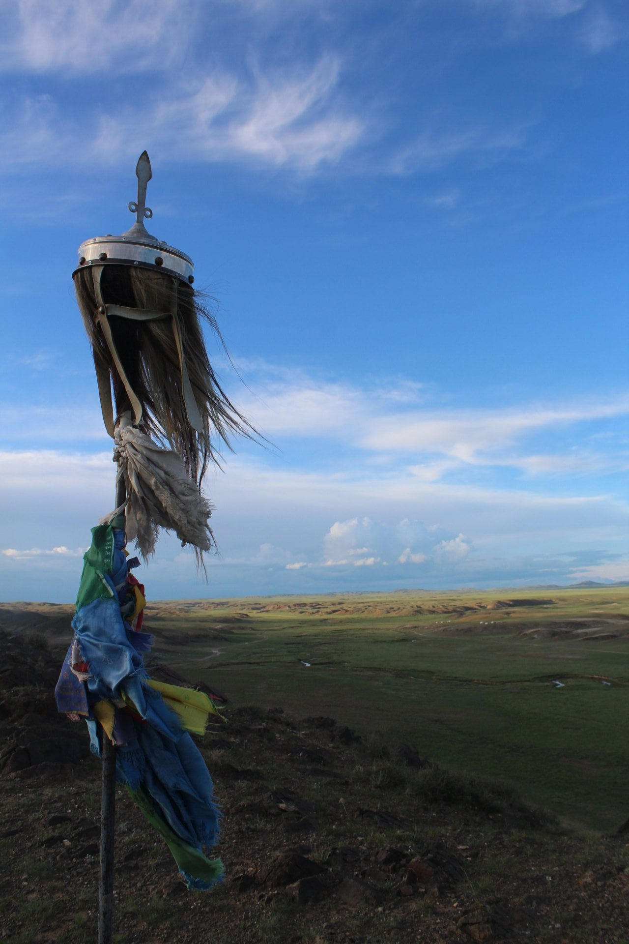 A horse-hair banner adorns a hillside monument in central Bayankhongor province, Mongolia. (Credit: William Taylor)