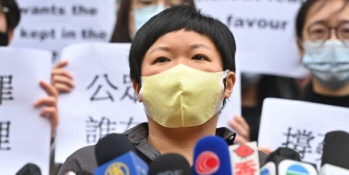 Hong Kong reporter Bao Choy speaking to the press.
