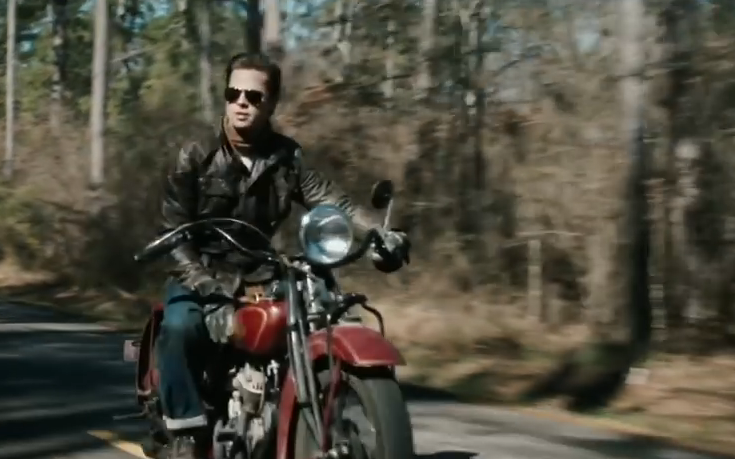 Brad Pitt riding a motorcycle, a shot from the movie 'The Curious Case of Benjamin Button'