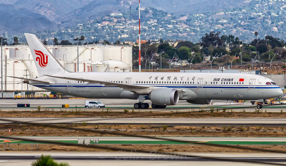 Air China Boeing 787-9 aircraft sitting on the runway.