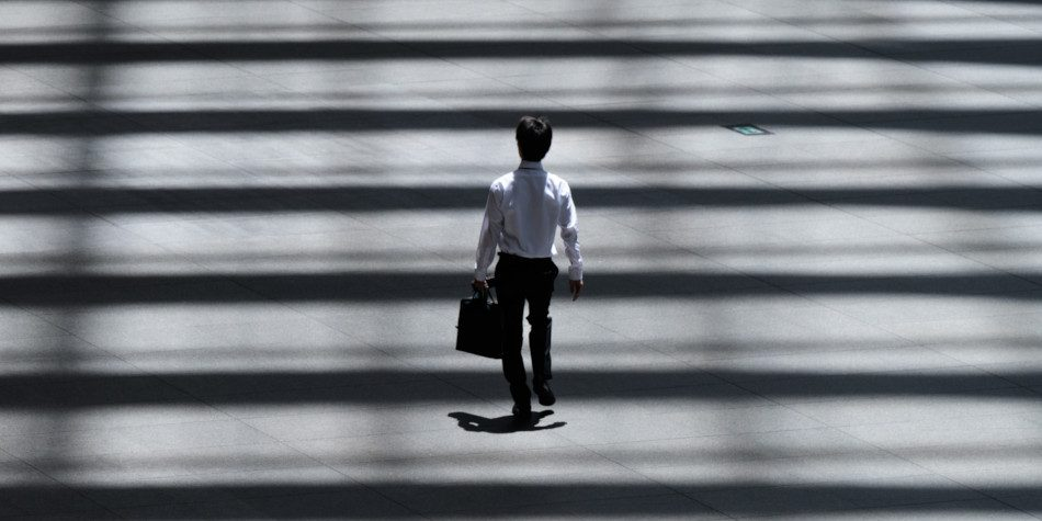 An Asian businessman carrying a briefcase.