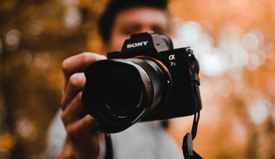 Man holding a camera.