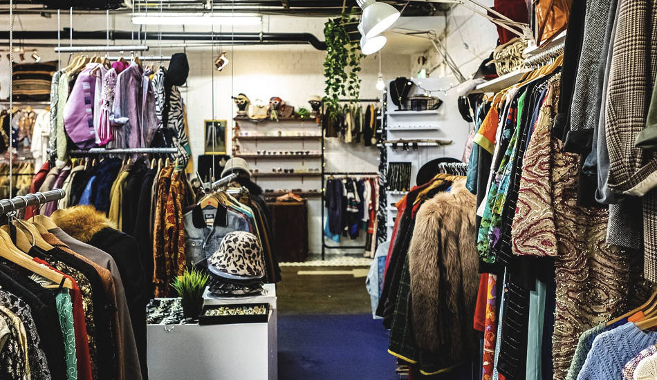 Racks of clothing in a store.