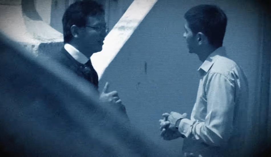 Two Chinese men talking.