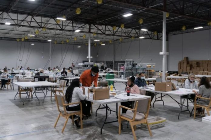 election counters counting ballots for the us 2020 election in georgia, which is undergoing a hand recount