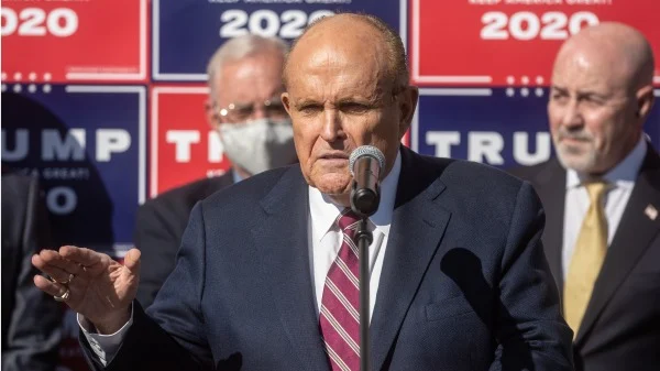 Trump's personal lawyer and former New York City mayor Rudy Giuliani speaks about evidence of alleged voter fraud on Nov. 7, 2020 at an event in Pennsylvania with Trump signs in background